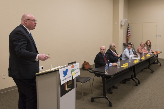 Steve Sebelius, political columnist with the Las Vegas Review-Journal, left, moderates a forum hosted by the Guinn Center for Policy Priorities at Centennial Hills Library in Las Vegas Wednesday,  ...