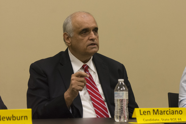 Len Marciano, candidate for State Board of Education District 4, speaks during a forum hosted by the Guinn Center for Policy Priorities at Centennial Hills Library in Las Vegas Wednesday, May 25,  ...