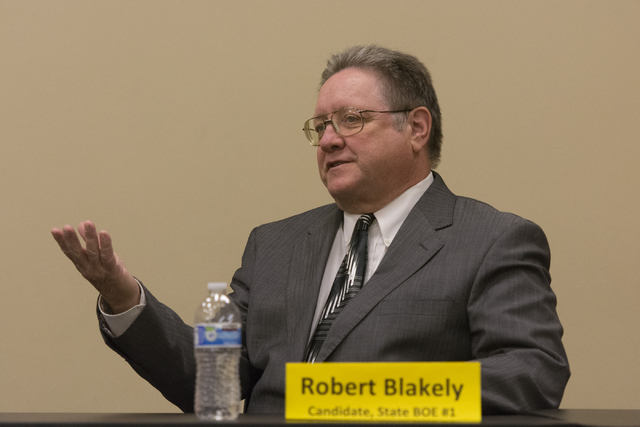 Robert Blakely, candidate for State Board of Education District 1, speaks during a forum hosted by the Guinn Center for Policy Priorities at Centennial Hills Library in Las Vegas Wednesday, May 25 ...