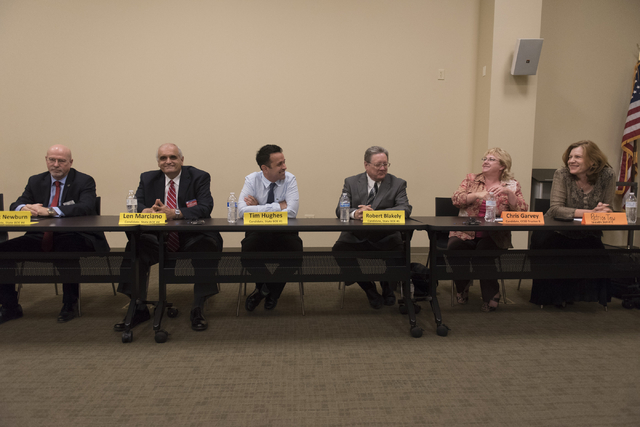 From left, Mark Newburn, Len Marciano, Tim Hughes, Robert Blakely, Chris Garvey and Patrice Tew, sit on a panel during a forum hosted by the Guinn Center for Policy Priorities at Centennial Hills  ...