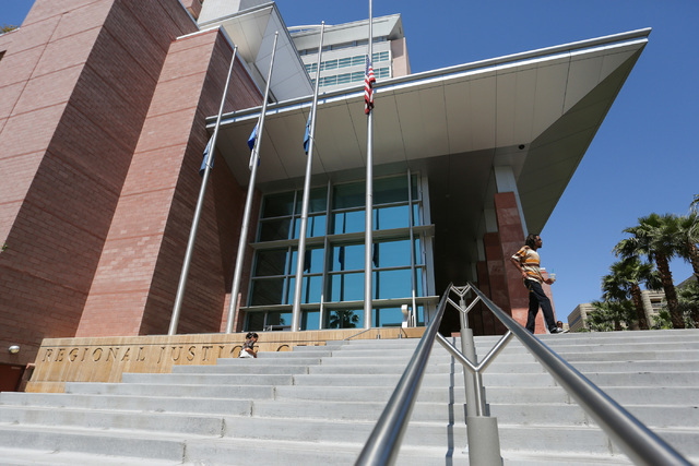 Flags fly at half-staff at the Regional Justice Center, almost two weeks after they were supposed to be raised to full-staff, in Las Vegas on Thursday, May 26, 2016. Brett Le Blanc/Las Vegas Revie ...