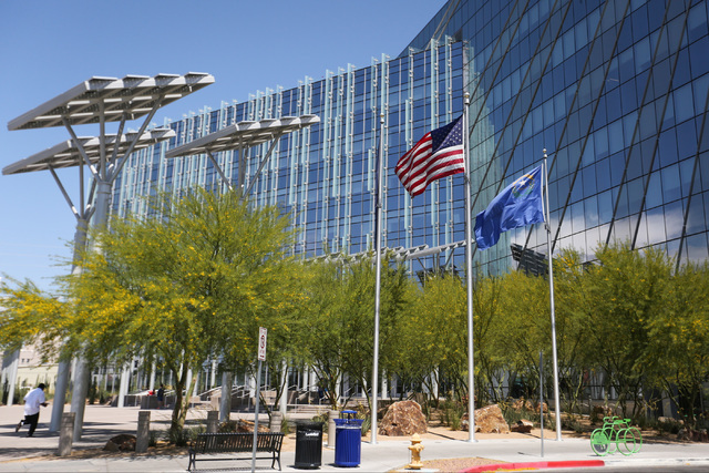 Flags fly at full-staff at City Hall, while flags at the Regional Justice Center remained at half-staff, almost two weeks after they were supposed to be raised, in Las Vegas on Thursday, May 26, 2 ...