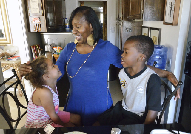 Breast cancer survivor Lorinne Rodgers, center, talks with her grandchildren Tiara, left, and Deshawn Rodgers at her home in Las Vegas on Monday, May 2, 2016. Bill Hughes/Las Vegas Review-Journal
