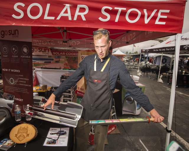 Sales manager Peter Harten pulls a tube full of homemade sugar cookies out of the GoSun Sport solar stove, Friday, May 6, 2016, at the 71st National Hardware Show in the Las Vegas Convention Cente ...