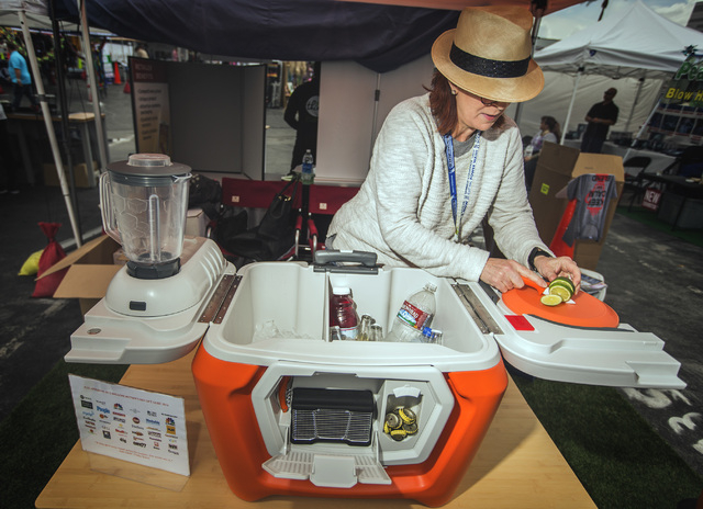 Susan Towers, marketing director for Coolest, slices limes on the Coolest Cooler Friday, May 6, 2016 at the 71st National Hardware Show in the Las Vegas Convention Center parking lot. The cooler a ...