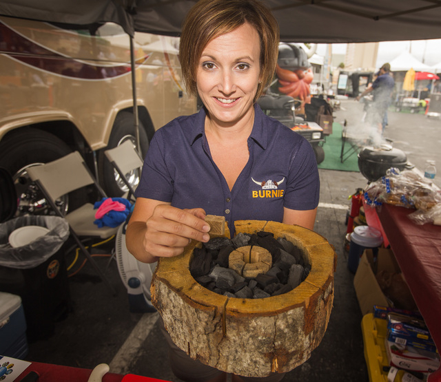 Nicole Cartica holds the Burnie, all wood self-burning grill, Friday, May 6, 2016, at the 71st National Hardware Show in the Las Vegas Convention Center parking lot. Jeff Scheid/Las Vegas Review-J ...