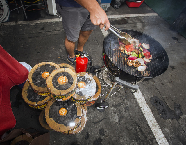 Stephen Spadaro grills vegetables using the Burnie, all wood self-burning grill, Friday, May 6, 2016, at the 71st National Hardware Show in the Las Vegas Convention Center parking lot. Jeff Scheid ...