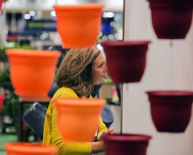 Plastic pots frame around Kathy Strive in the Bloem booth, Friday, May 6, 2016, at the 71st National Hardware Show in the Las Vegas Convention Center. Jeff Scheid/Las Vegas Review-Journal Follow @ ...