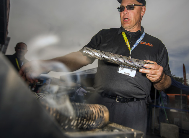 Todd Johnson explains the A-Maze-M tube smoker, Friday, May 6, 2016, at the 71st National Hardware Show in the Las Vegas Convention Center parking lot. Jeff Scheid/Las Vegas Review-Journal Follow  ...