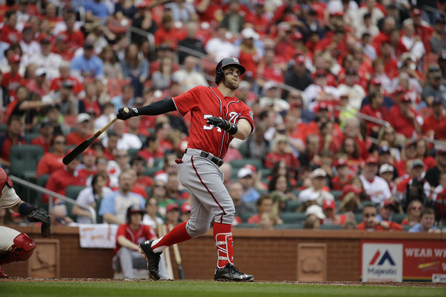 Washington Nationals' Bryce Harper swings during the third inning of a baseball game against the St. Louis Cardinals Saturday, April 30, 2016, in St. Louis. (AP Photo/Jeff Roberson)