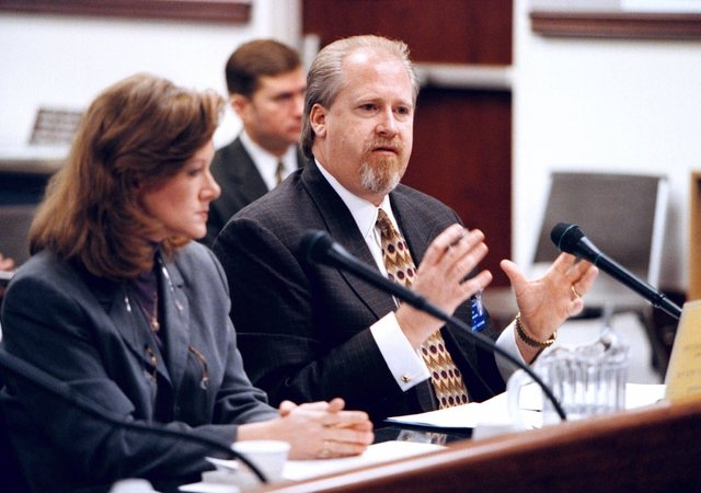 Carol O'Hare, left, executive director of the Nevada Council on Problem Gambling, listens as Harvey Whittemore, top lobbyist for Nevada's major casinos, testifies during the Senate Judiciary heari ...