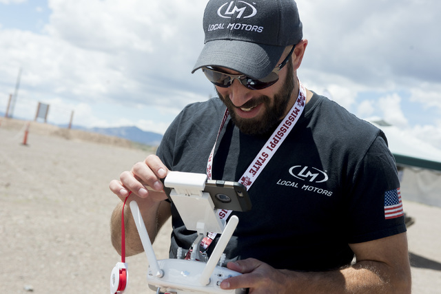 Alex Palmer of Local Motors plays around with taking photos from a drone. In honor of International Drone Day, Aerodrome held a drone flying day on May 7, 2016, in Boulder City. Bridget Bennett/Vi ...