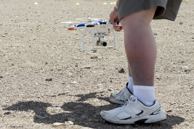 Paul Hirsch picks up his drone after running it through the course. In honor of International Drone Day, Aerodrome held a drone flying day on May 7, 2016, in Boulder City. Bridget Bennett/Las Vega ...