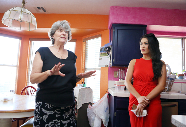 Living Grace Home executive director Kathleen Miller, left, gives a tour at the nonprofit home Wednesday, April 20, 2016, in Henderson. Previous resident Marianne Canada stands nearby. (Ronda Chur ...