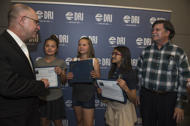 Director of the International Space Station Sam Scimemi, left, greets Vanderburg Elementary fifth-graders Avery Sanford, 11; Kendall Allgower, 11, and Shani Abeyakoon, 10, and their Gifted and Tal ...