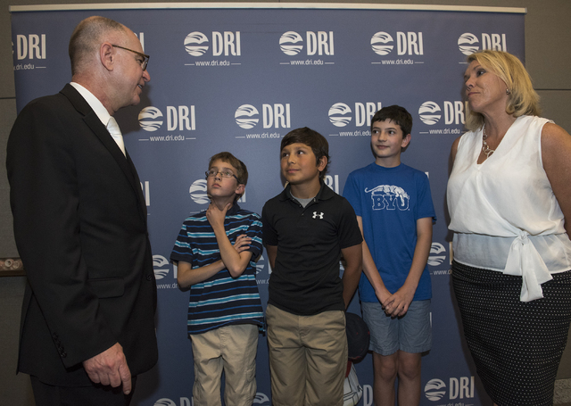 Director of the International Space Station Sam Scimemi, left, greets Batterman Elementary fifth-graders Tyler Hockersmith, 11; Kaiden Hernandez, 10; Levi Landers, 11, and their Gifted and Talente ...