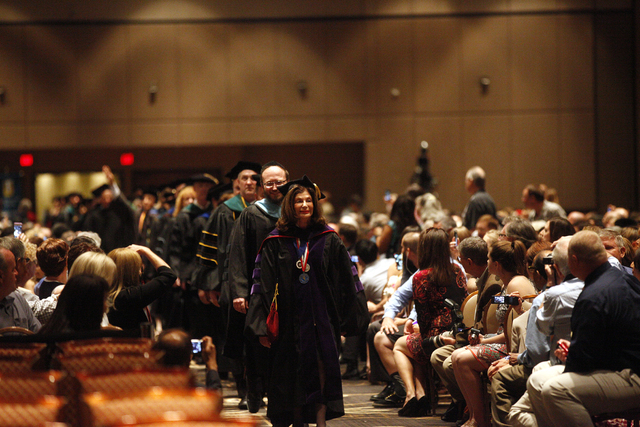 Former Congresswoman Shelley Berkely leads the Touro University Nevada faculty and graduates into the ballroom at the beginning of the graduation ceremony at the Rio Hotel and Casino Sunday, May 1 ...