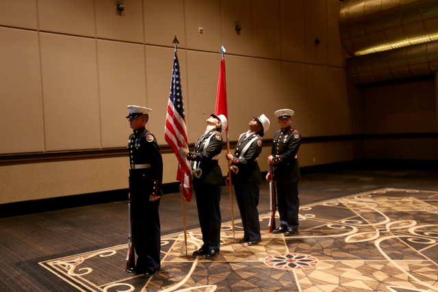 Mark Stratton, left, Kailee Moore, Jackie Williams, and Vincent Laub of the ROTC color guard wait to perform at Touro University Nevada's graduation ceremony at the Rio Hotel and Casino Sunday, Ma ...