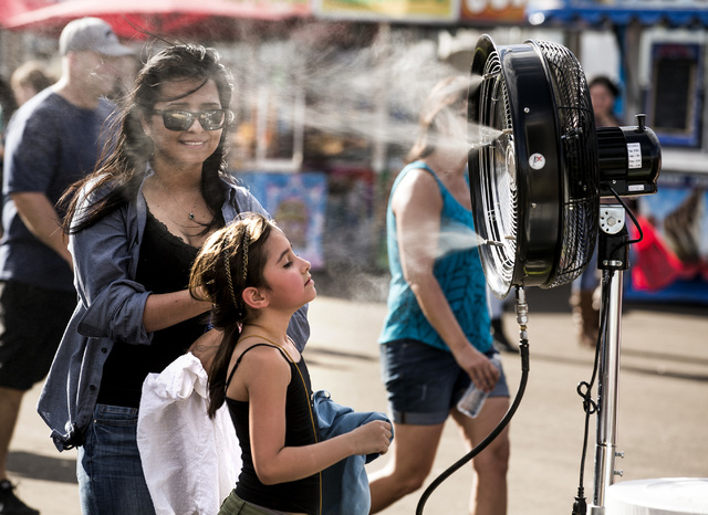 Rachel Lauer,left, and her daughter Jean cool down in front of a misting fan at Las Vegas Helldorado Days within the Las Vegas Village on Friday, May, 13, 2016. (Jeff Scheid/Las Vegas Review-Journ ...