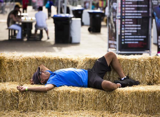 A man takes a nap on straw bales at Las Vegas Helldorado Days within the Las Vegas Village on Friday, May, 13, 2016. (Jeff Scheid/Las Vegas Review-Journal)  Follow @jlscheid