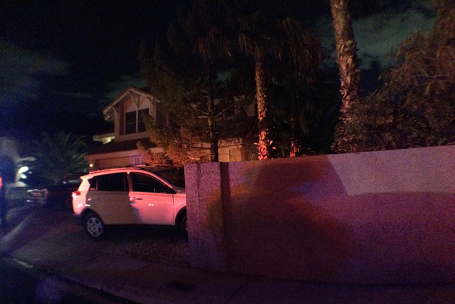 Police investigate the scene on the 2900 block of Setting Sun Street where a man crashed a car into a dividing wall after stealing it from another home. (Thomas Moore/Las Vegas Review-Journal)