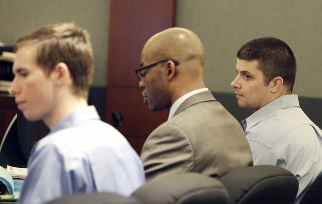 Sinder Holmes, left, and Matthew Goin, right, appear with Goin's attorney Jonathan MacArthur, center, at the Regional Justice Center on Wednesday, May 18, 2016. Goin and Holmes admitted to raping  ...