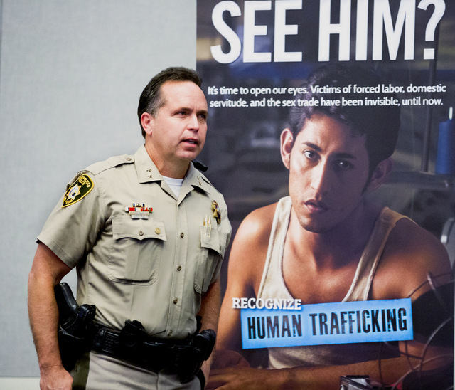 Assistant Sheriff Thomas Roberts, of Las Vegas Metropolitan Police Department, prepares to speak during a seminar on human trafficking and child exploitation at Lloyd George U.S. Courthouse in Las ...