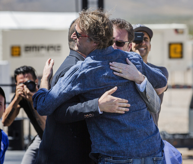 Hyperloop One executives Shervin Pishevar, left, co-founder, executive chairman, Brogan Bam Brogan, chief technology officer, and Rob Lloyd, CEO, congratulate each other after the first public tes ...