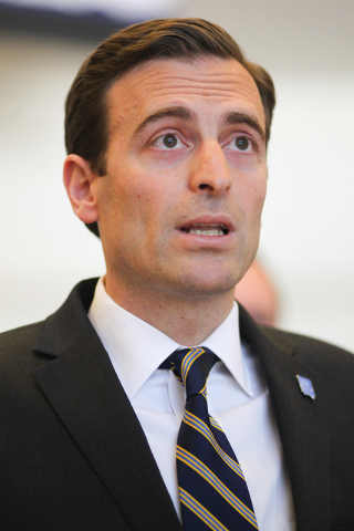 Nevada Attorney General Adam Laxalt speaks with news media about the arrest warrant being issued for Bryan Micon, who ran an illegal poker site which was shut down, at the Sawyer Building in Las V ...