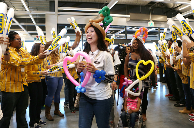 Customers, including the first to enter Nevada's first IKEA store, Junie Zhu, of Las Vegas, smiles as she enters the store on Wednesday, May 18, 2016. Zhu camped outside the store since last Monda ...