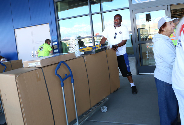 Michael Bailey of Las Vegas exits Nevada's first IKEA store after receiving his free couch, for being the 41st customer in line, during the grand opening on Wednesday, May 18, 2016. Bizuayehu Tesf ...