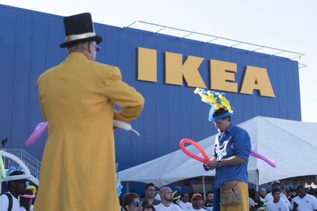 Andy Thogersen, right, and Charlie Strong make balloon hats for patrons during the opening day event for IKEA in Las Vegas Wednesday, May 18, 2016. Jason Ogulnik/Las Vegas Review-Journal
