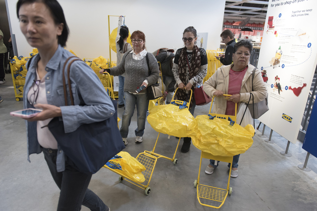 Patrons grab shopping carts and bags during the opening day event for IKEA in Las Vegas Wednesday, May 18, 2016. Jason Ogulnik/Las Vegas Review-Journal