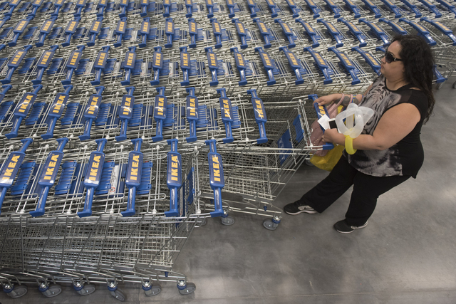 Zulett Miller grabs a shopping cart during the opening day event for IKEA in Las Vegas Wednesday, May 18, 2016. Jason Ogulnik/Las Vegas Review-Journal