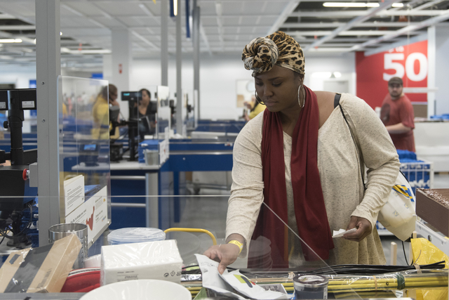 Urian Booze places her purchases on the checkout counter during the opening day event for IKEA in Las Vegas Wednesday, May 18, 2016. Jason Ogulnik/Las Vegas Review-Journal