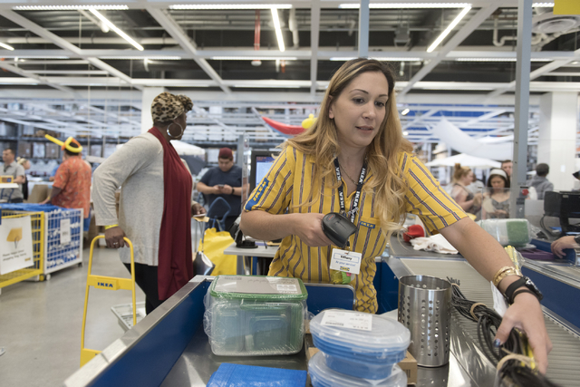 Cashier Tiffany Nakano, right, assists Urian Booze with her purchases during the opening day event for IKEA in Las Vegas Wednesday, May 18, 2016. Jason Ogulnik/Las Vegas Review-Journal
