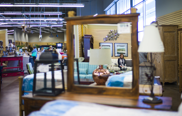 Colleen Aiken, owner of Colleen's Classic Consignment, poses for a photo, reflected in a mirror, in one of her stores at 5120 S. Fort Apache Road in Las Vegas on Friday, May 6, 2016. Chase Stevens ...