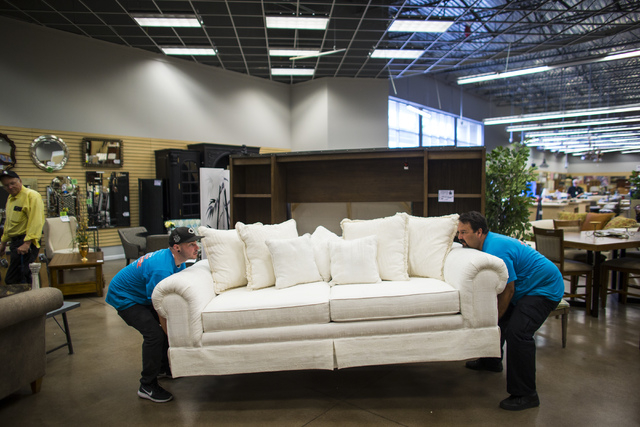 Matt Bernstein, left, and Joseph Del Rio moves a couch in Colleen's Classic Consignment at 5120 S. Fort Apache Road in Las Vegas on Friday, May 6, 2016. Chase Stevens/View Follow @csstevensphoto