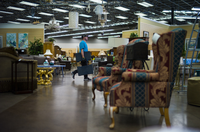 Matt Bernstein helps with rearranging items in Colleen's Classic Consignment at 5120 S. Fort Apache Road in Las Vegas on Friday, May 6, 2016. Chase Stevens/View Follow @csstevensphoto