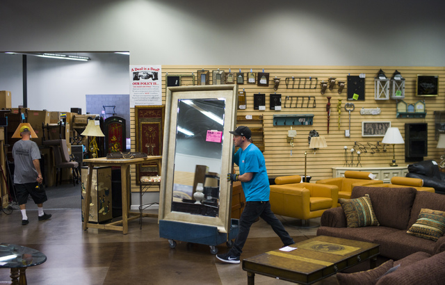 Matt Bernstein moves a mirror in Colleen's Classic Consignment at 5120 S. Fort Apache Road in Las Vegas on Friday, May 6, 2016. Chase Stevens/View Follow @csstevensphoto