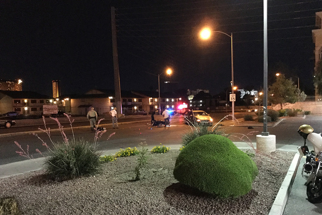 Police work at the scene where a motorcycle and a car collided on Swenson Street north of Flamingo Road. The motorcyclist died following the crash. (Greg Haas /Las Vegas Review-Journal Follow @RJg ...