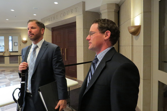 Matt Griffin, left, and Kevin Benson, attorneys for the Coalition for Nevada's Future, speak outside the Nevada Supreme Court chamber in Carson City on Monday, May 2, 2016. (Sandra Chereb/Las Vega ...