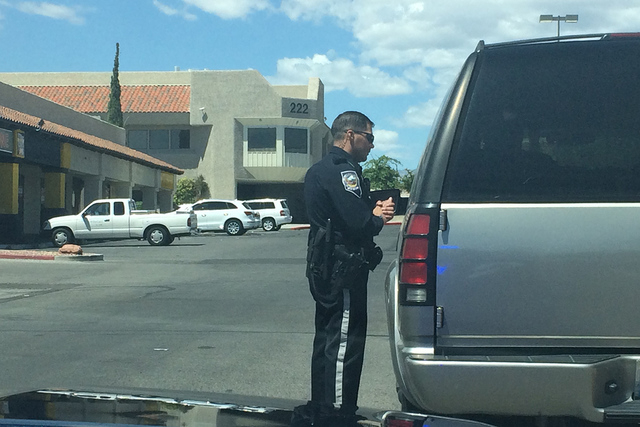 Nevada Highway Patrol trooper Sam Acosta is seen speaking with a driver after pulling him over on Monday, May 16, 2016. This week marks the beginning of the national Click It or Ticket campaign, a ...