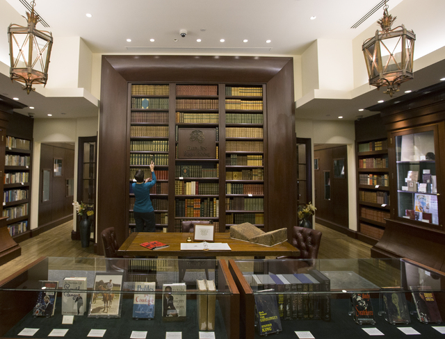 "Sales associate Mary Olsson organizes a shelf at Bauman Rare Books, Thursday, May 5, 2016, in Las Vegas. ""We cater to a very niche market,"" said Olsson. (Benjamin Hager/Las Vegas Review-Journal) F ..."
