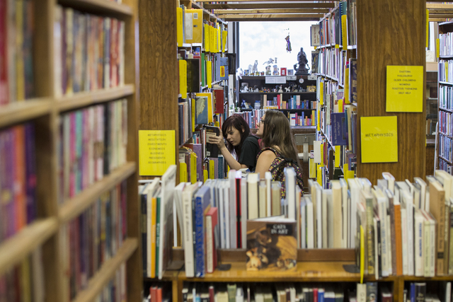 "Dana Dami, left, and Loralise Schoenfeldt shop for books at Amber Unicorn Books, Thursday, May 5, 2016, in Las Vegas. ""I like having the physical book,"" said Dami. ""It feels right to me."" (Benjami ..."