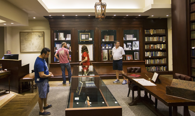 Shoppers peruse the shelves at Bauman Rare Books, Thursday, May 5, 2016, in Las Vegas. (Benjamin Hager/Las Vegas Review-Journal) Follow @benjaminhphoto