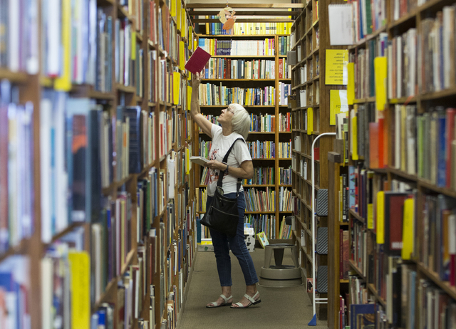 "Retired librarian Merilyn Grosshans shops for paperbacks at Amber Unicorn Books, Thursday, May 5, 2016, in Las Vegas. ""It's very important to have book stores in our midst,"" Grosshans said. (Benja ..."