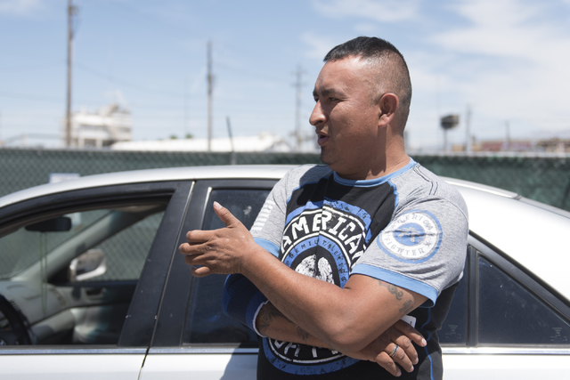 Jose Hernandez speaks with a reporter near the IRS office at 110 N. City Pkwy. in Las Vegas Thursday, May 19, 2016. (Jason Ogulnik/Las Vegas Review-Journal)