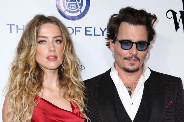 Amber Heard, left, and Johnny Depp arrive at The Art of Elysium's Ninth annual Heaven Gala at 3LABS, in Culver City, Calif., in January 2016. (Rich Fury/Invision/AP)