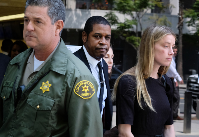 Actress Amber Heard leaves Los Angeles Superior Court court on Friday, May 27, 2016, after giving a sworn declaration that her husband Johnny Depp threw her cellphone at her during a fight Saturda ...